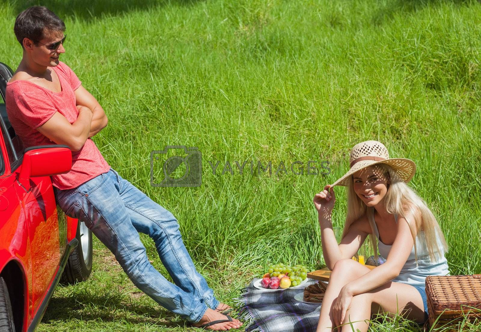 Happy couple having picnic together by Wavebreakmedia