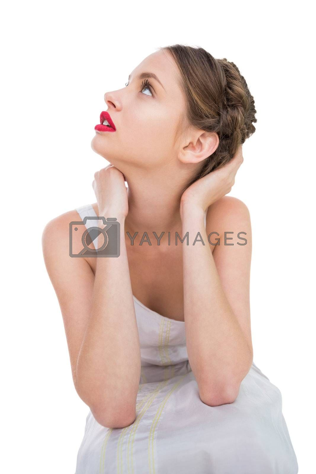 Beautiful woman sitting and looking up by Wavebreakmedia