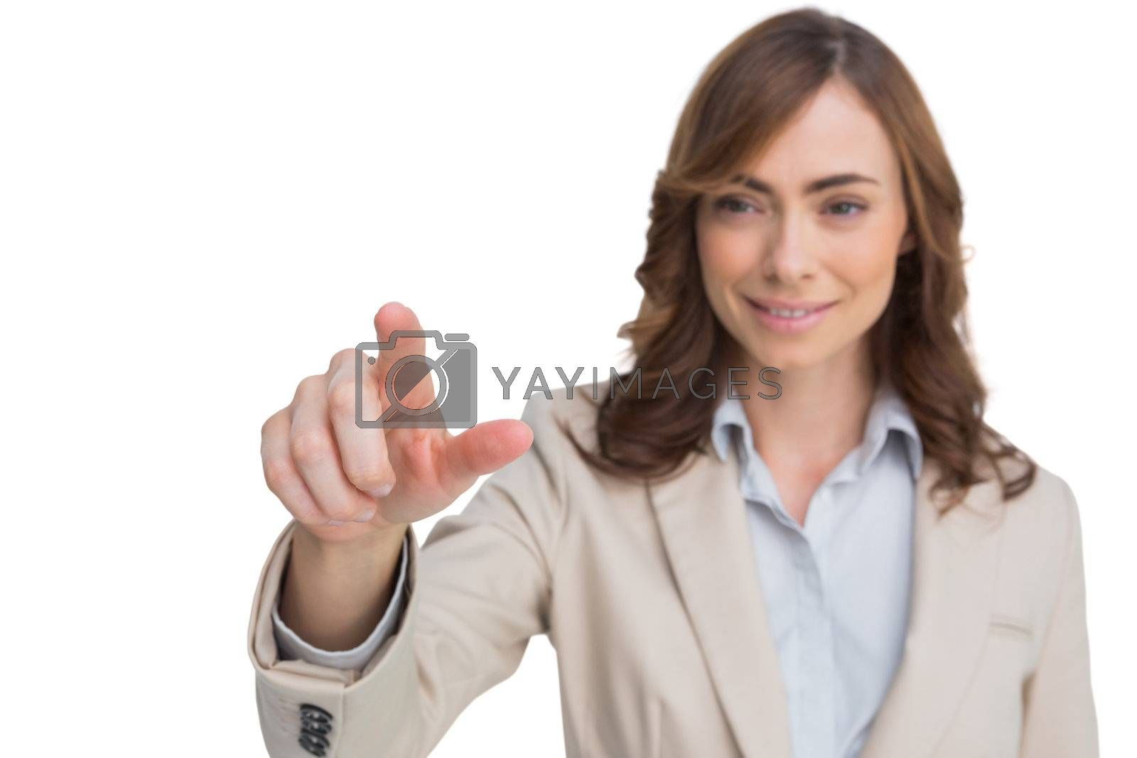 Portrait of businesswoman pointing her finger at camera by Wavebreakmedia