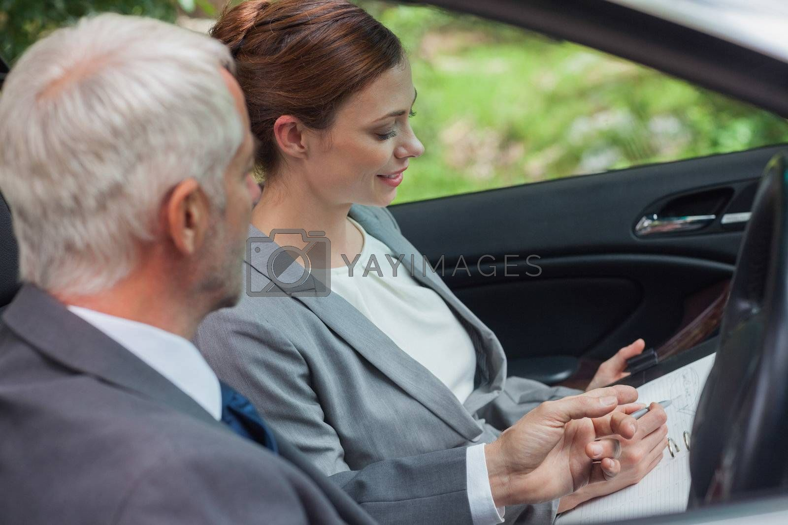 Partners working together in classy car by Wavebreakmedia