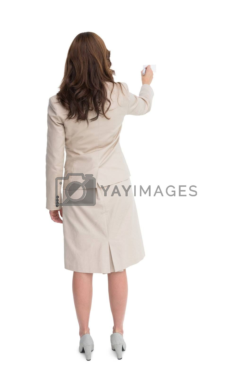 Businesswoman standing back to camera writing with marker by Wavebreakmedia