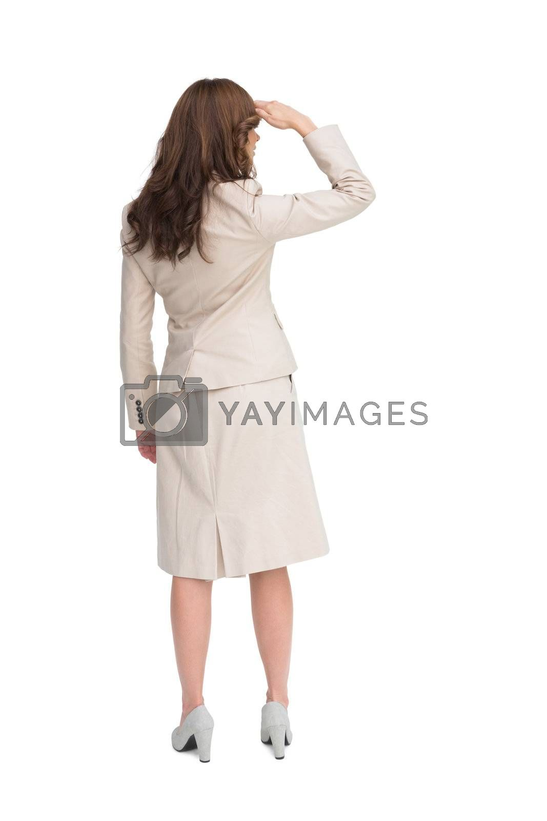 Rear view of young businesswoman looking away by Wavebreakmedia