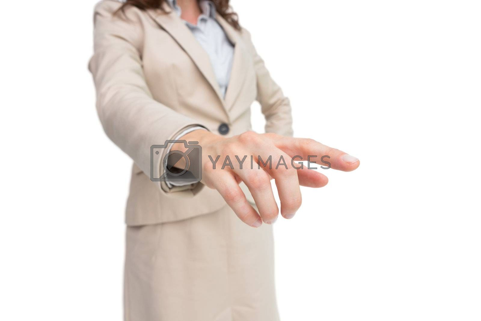 Stylish businesswoman touching invisible screen by Wavebreakmedia