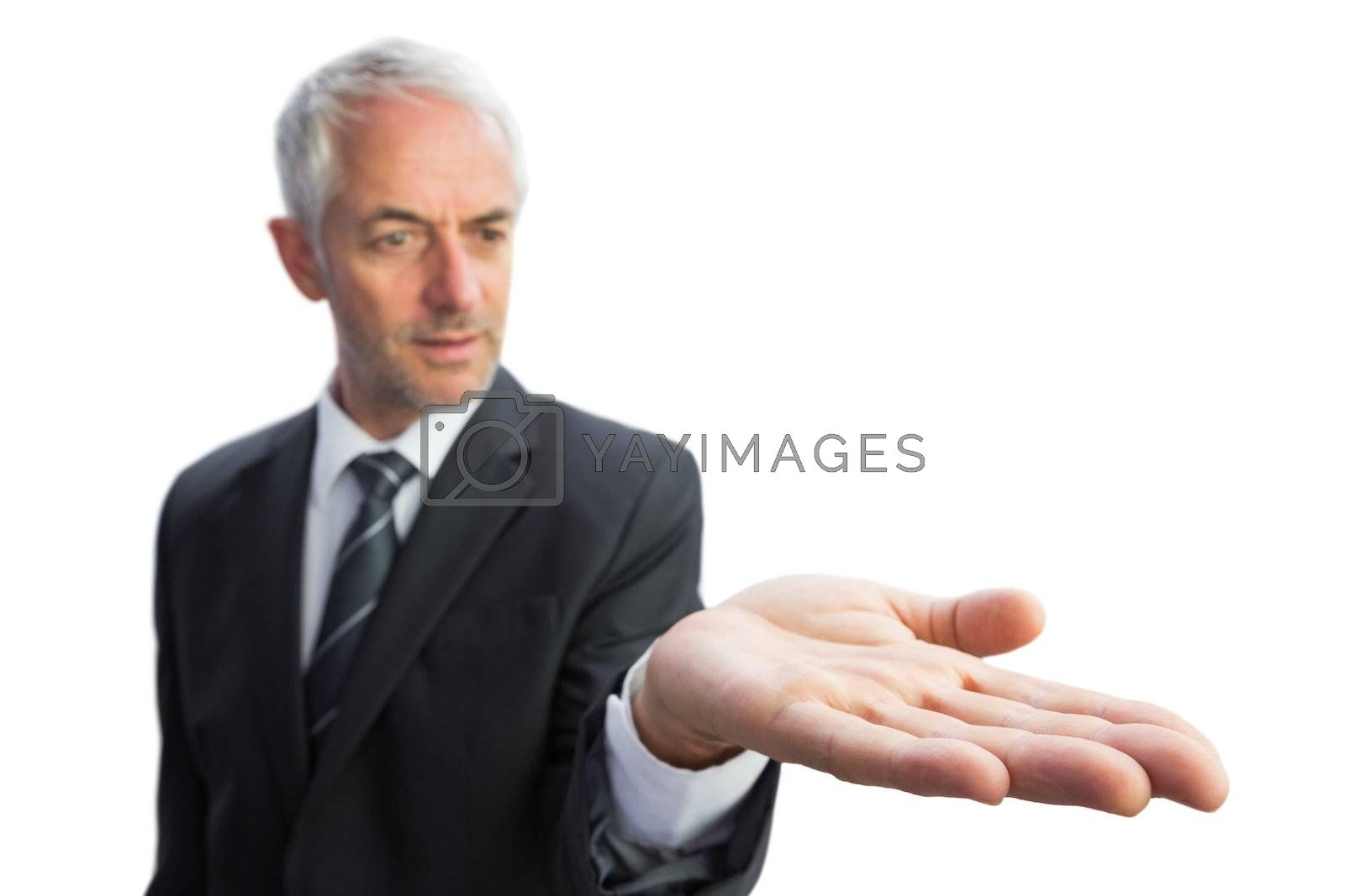 Concentrated businessman with palm up by Wavebreakmedia