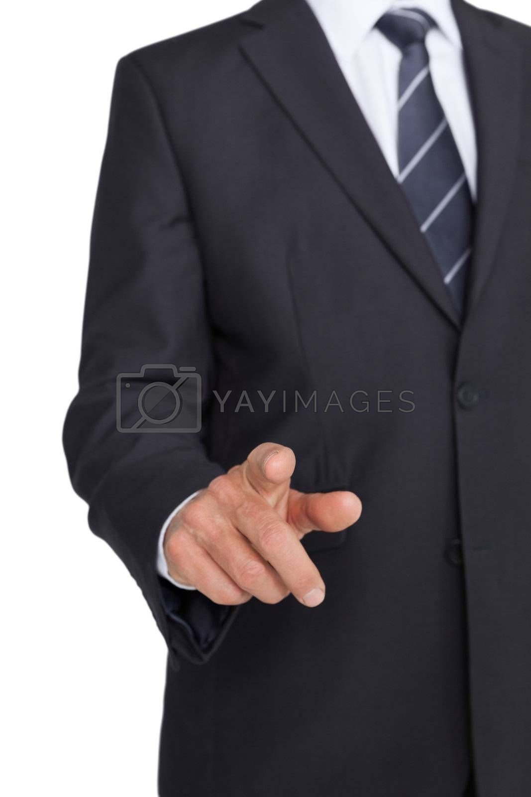 Businessman in suit pointing finger by Wavebreakmedia