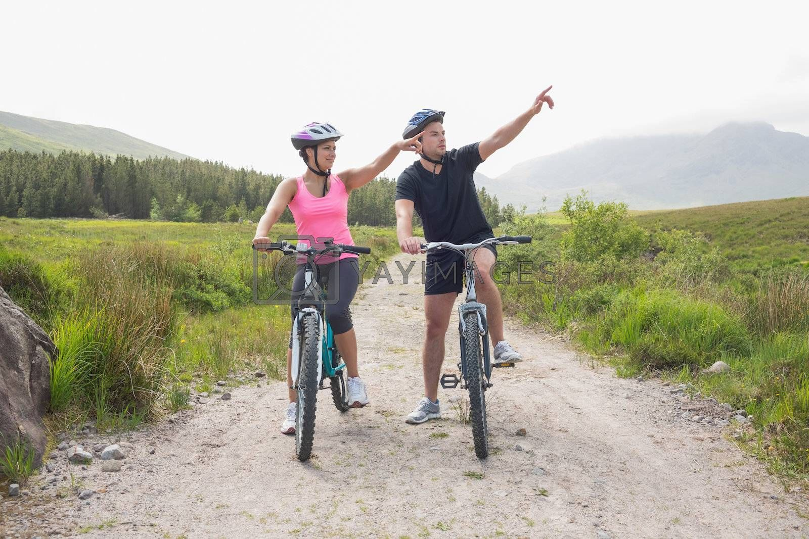 Athletic couple on a bike ride by Wavebreakmedia