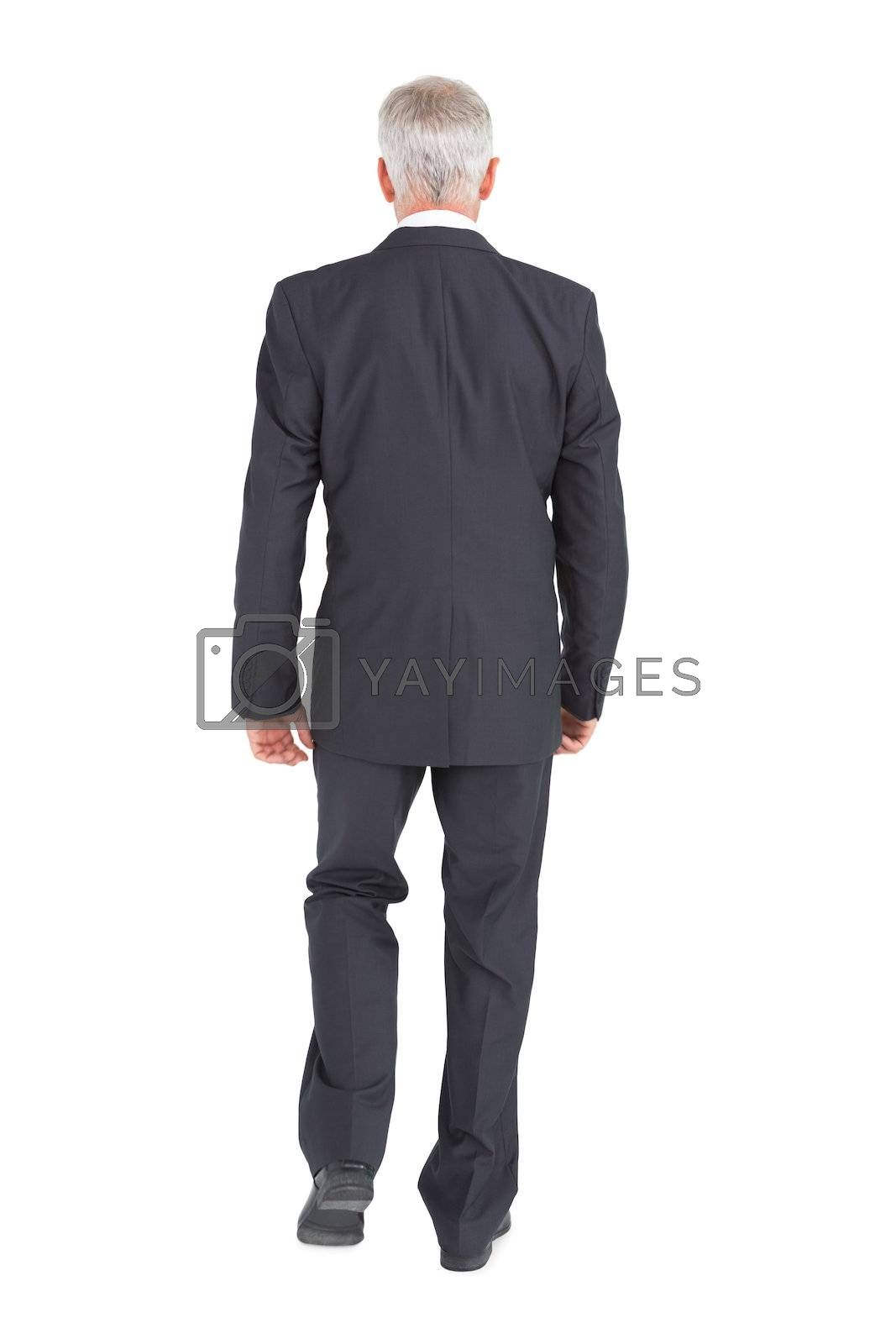Businessman walking away from camera by Wavebreakmedia