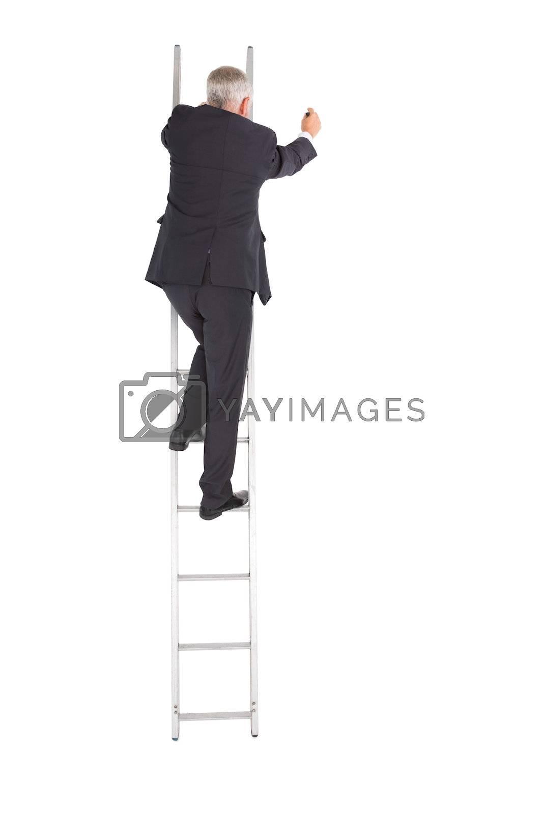 Mature businessman climbing career ladder  by Wavebreakmedia