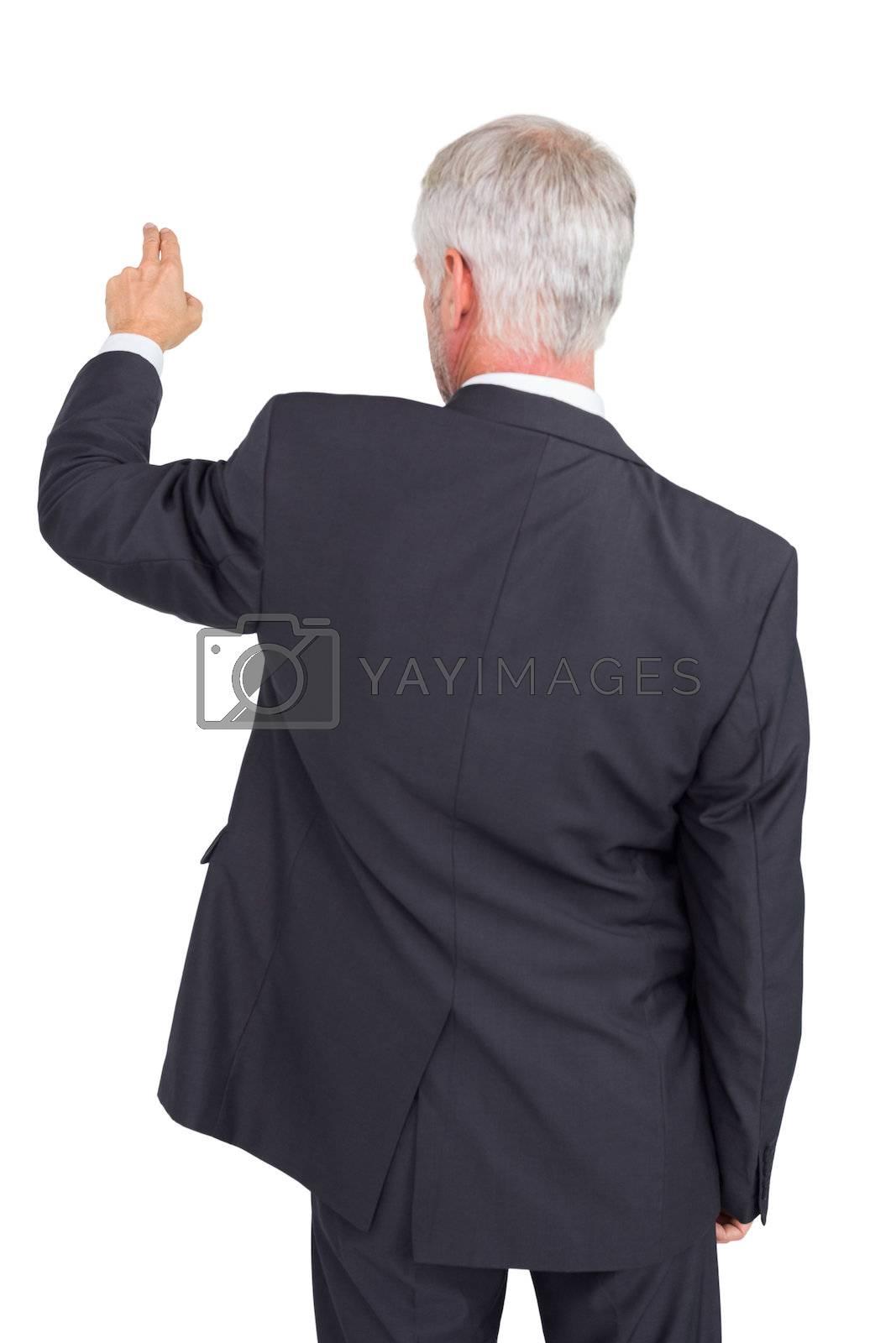 Businessman pointing at something by Wavebreakmedia