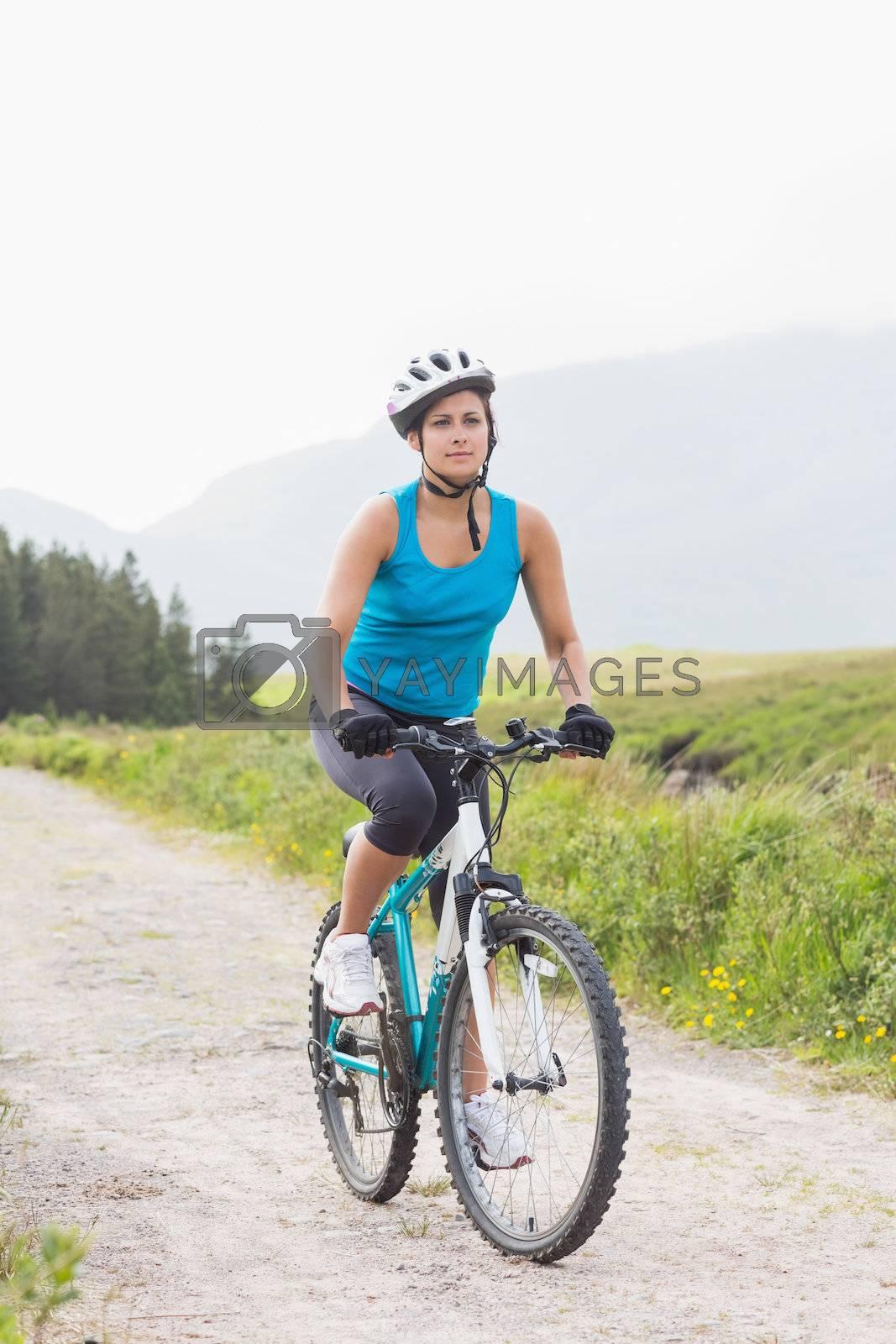 Fit woman riding mountain bike by Wavebreakmedia
