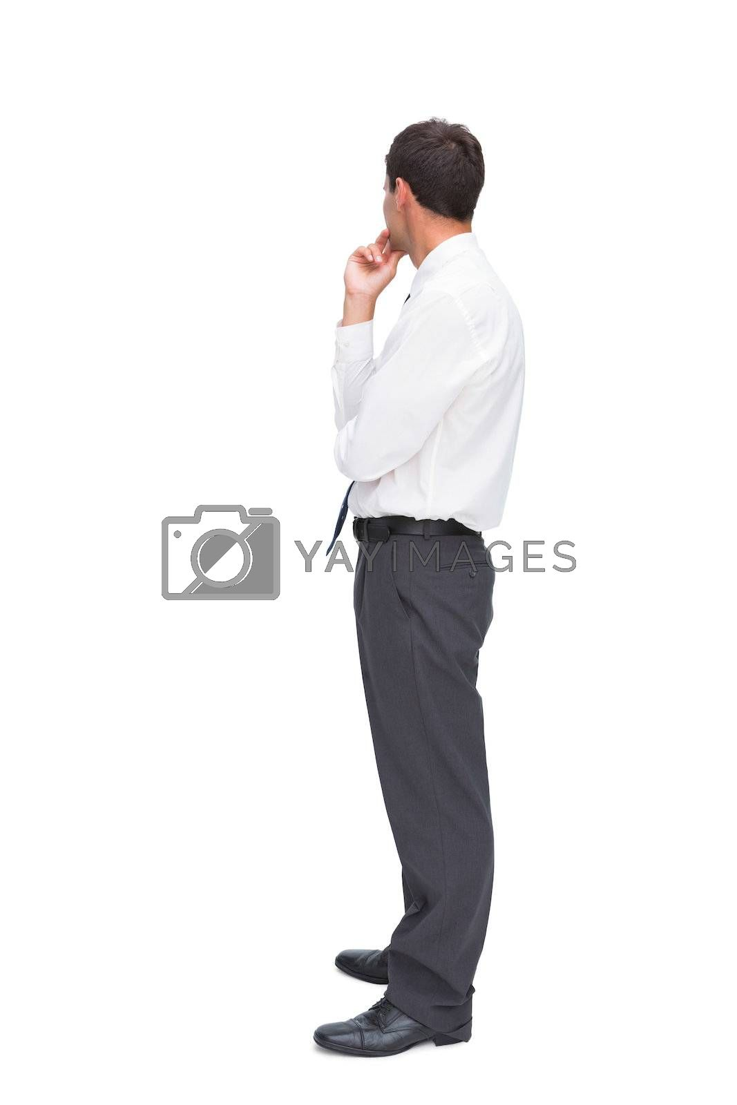 Thoughtful classy businessman looking away by Wavebreakmedia