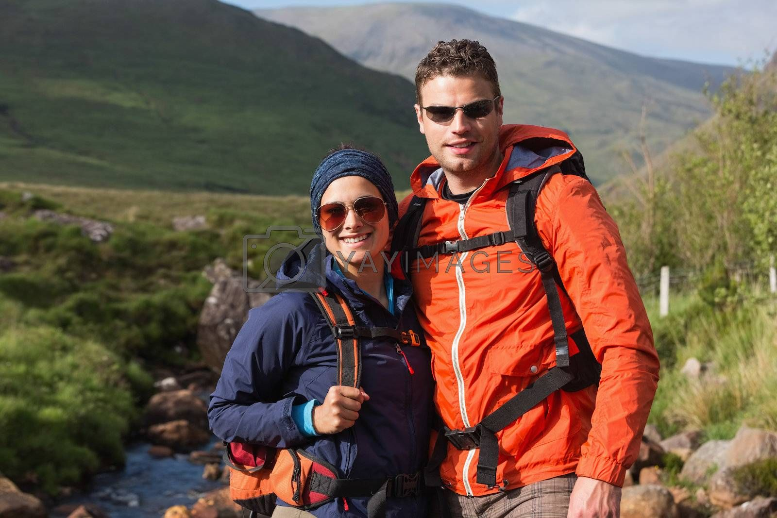 Happy couple on hike by Wavebreakmedia