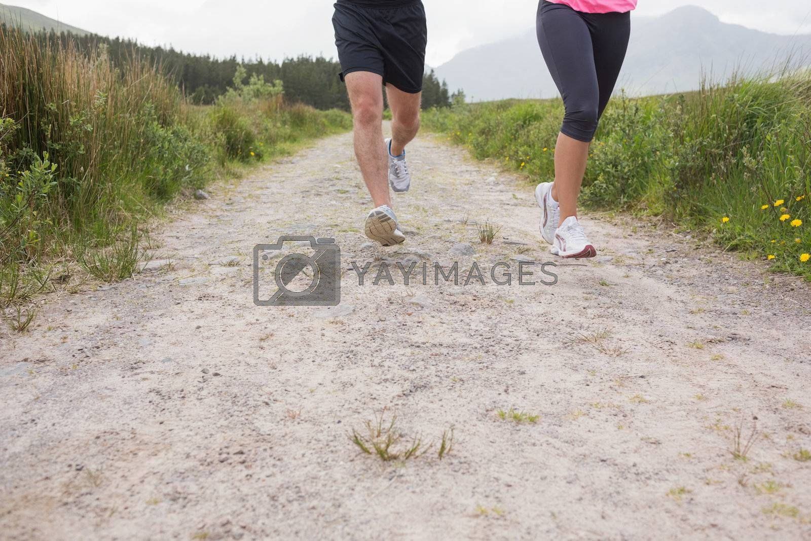 Couples feet running on trail by Wavebreakmedia