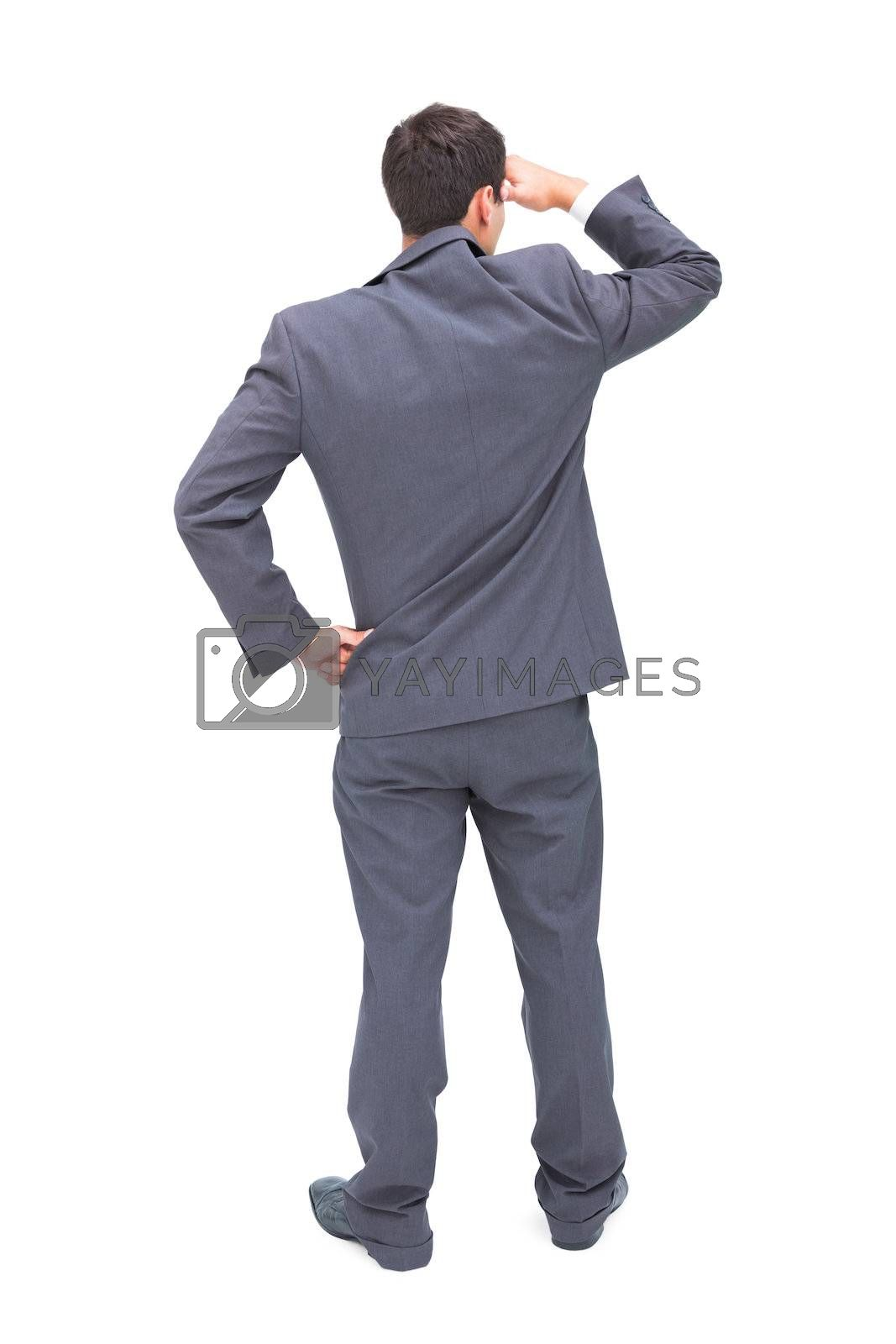 Rear view of young businessman looking away by Wavebreakmedia