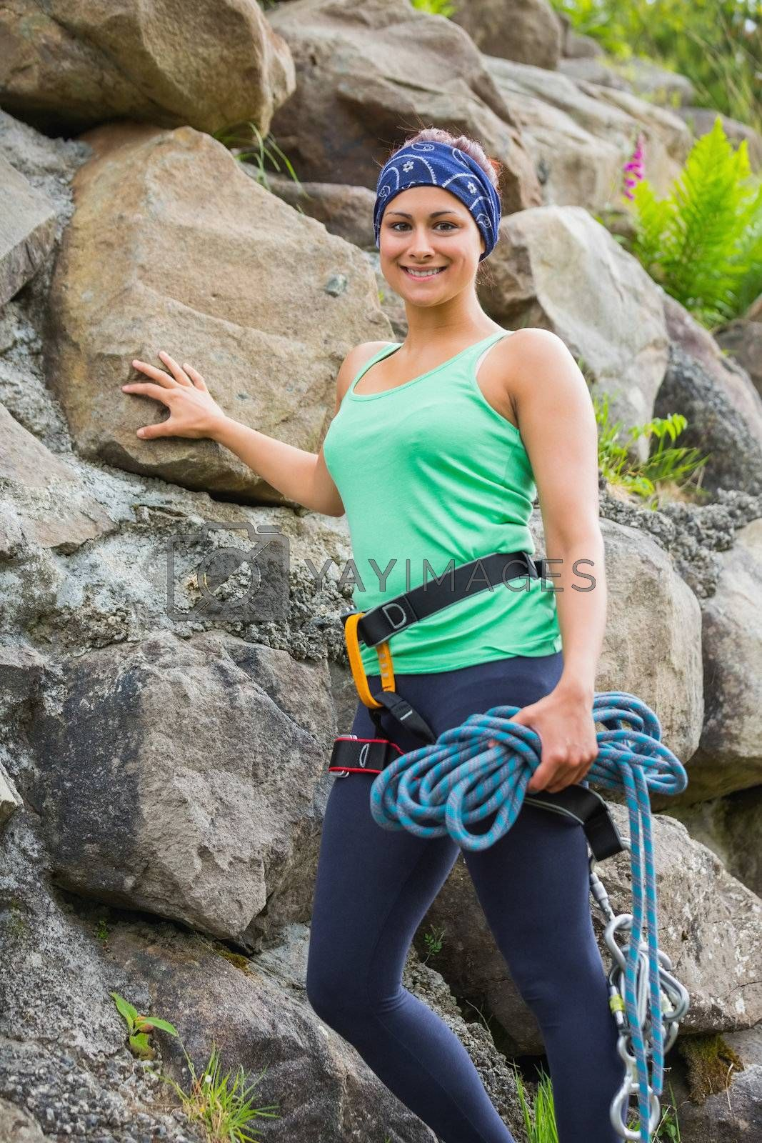 Attractive female rock climber smiling at camera by Wavebreakmedia