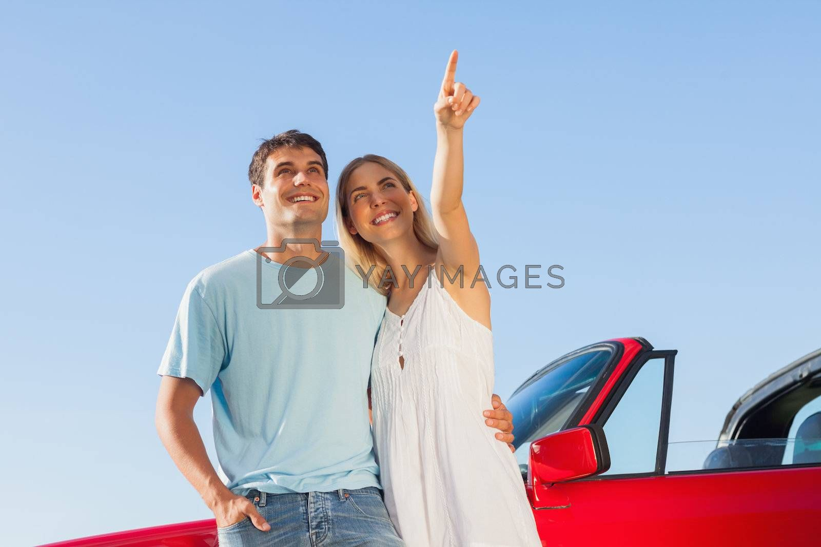 Smiling woman showing something to her handsome boyfriend by Wavebreakmedia