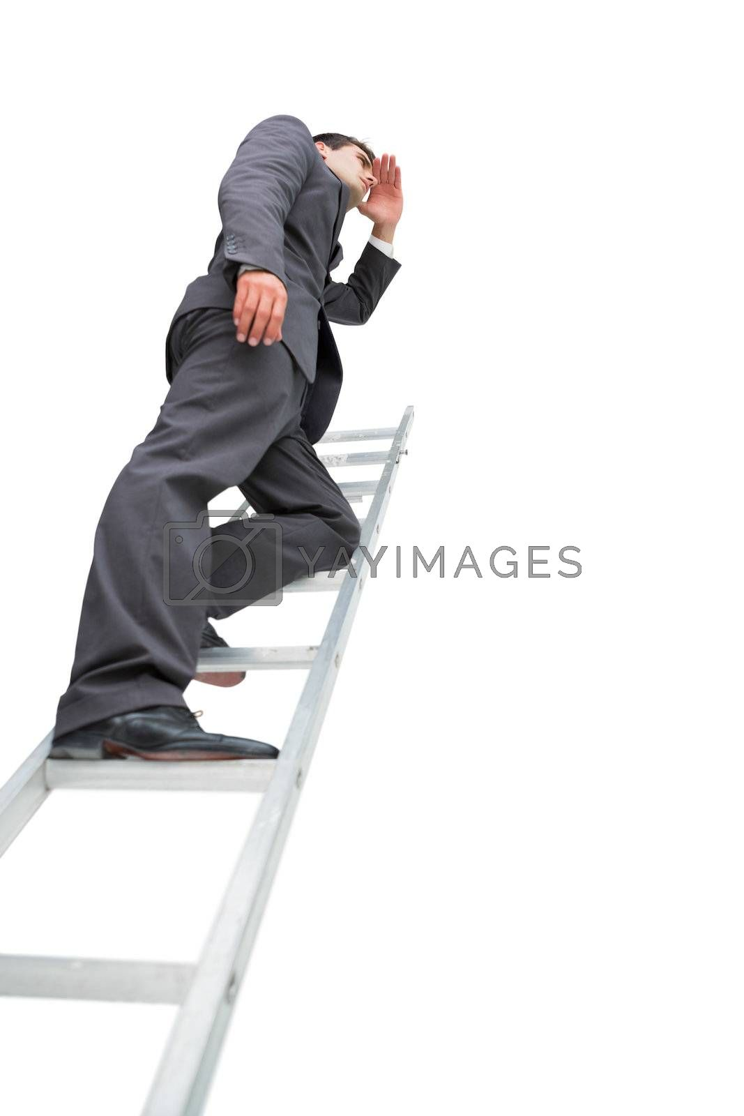 Low angle view of businessman standing on ladder by Wavebreakmedia
