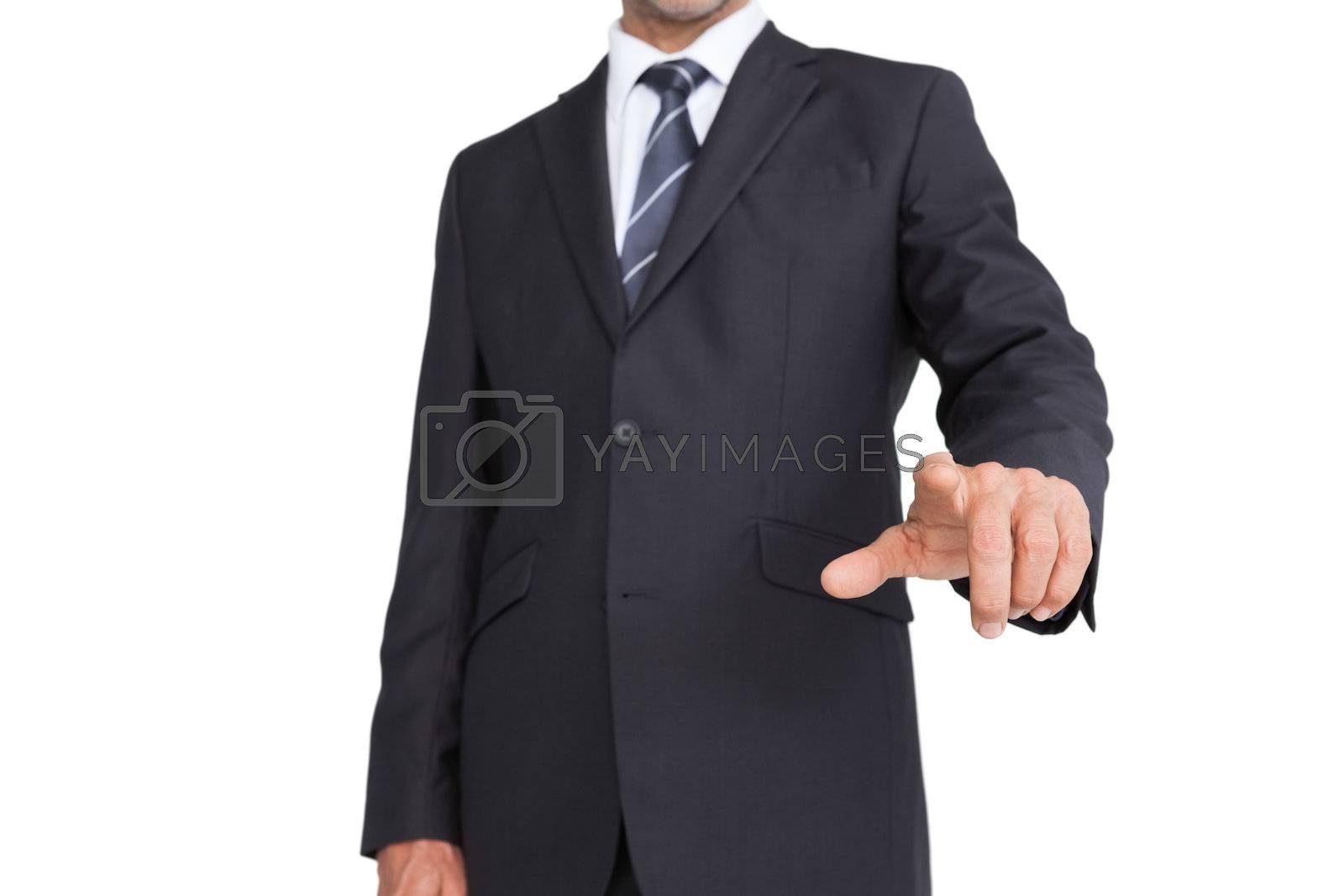 Classy businessman pointing finger by Wavebreakmedia