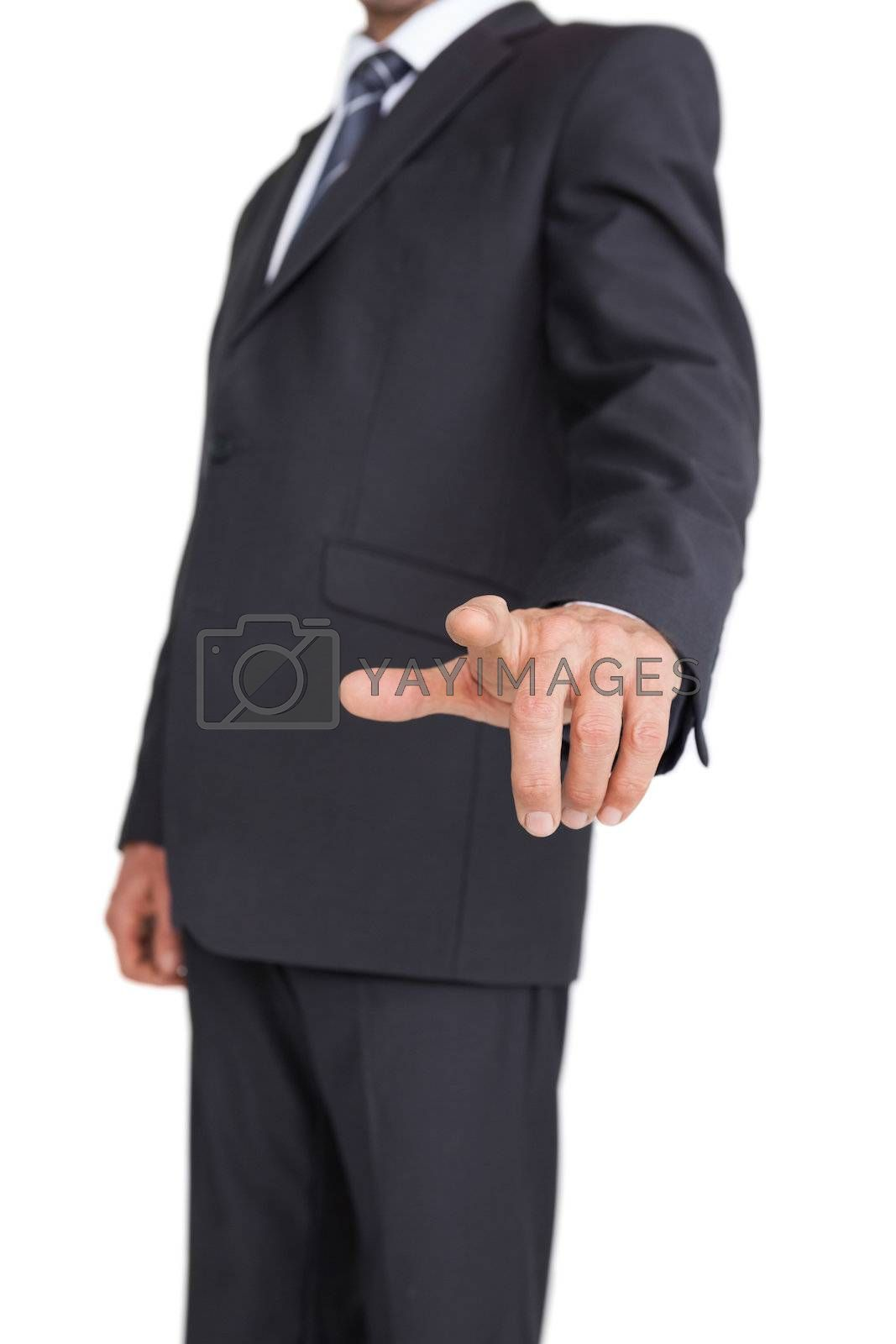 Stylish businessman pointing the finger by Wavebreakmedia