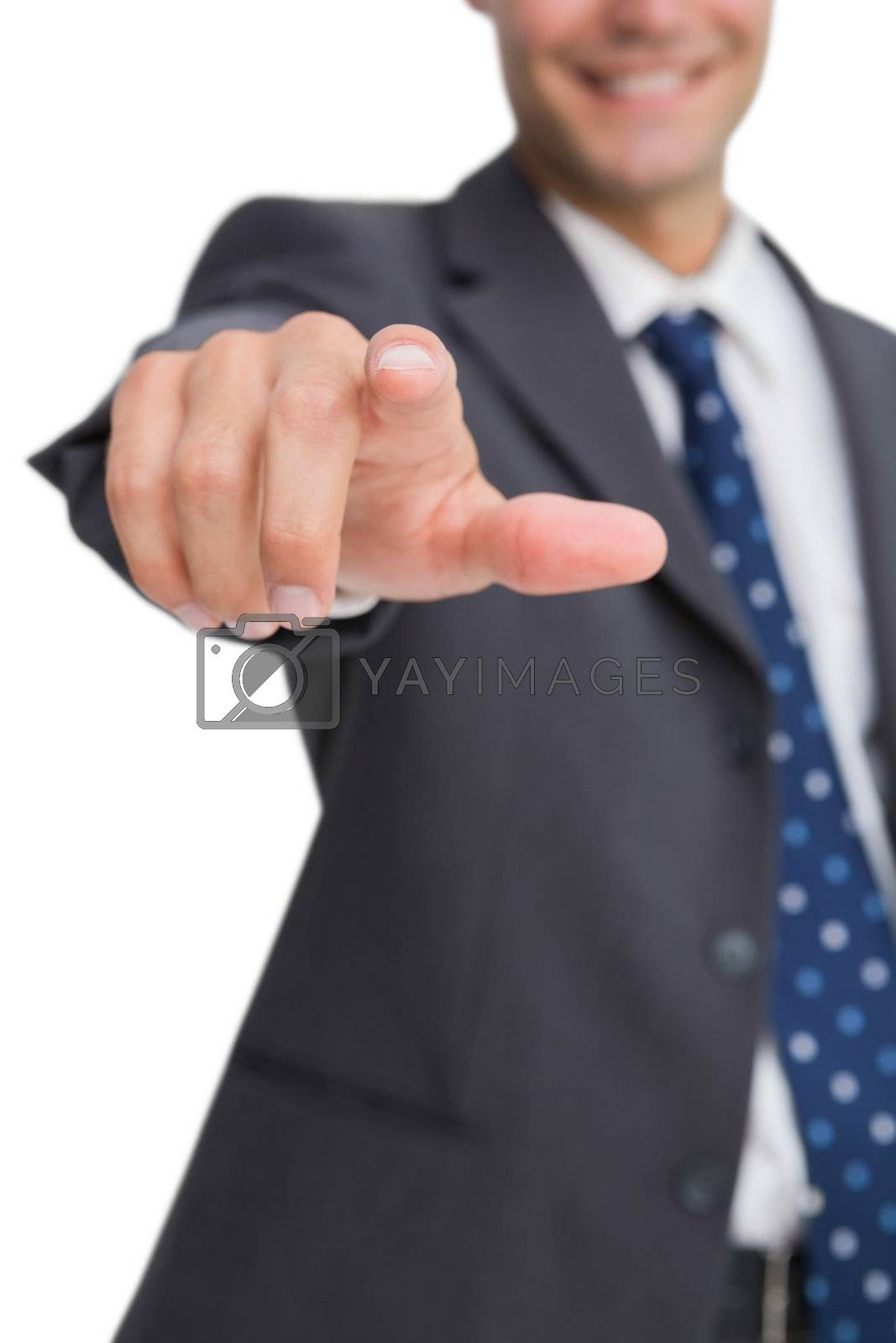 Finger of smiling businessman pointing by Wavebreakmedia