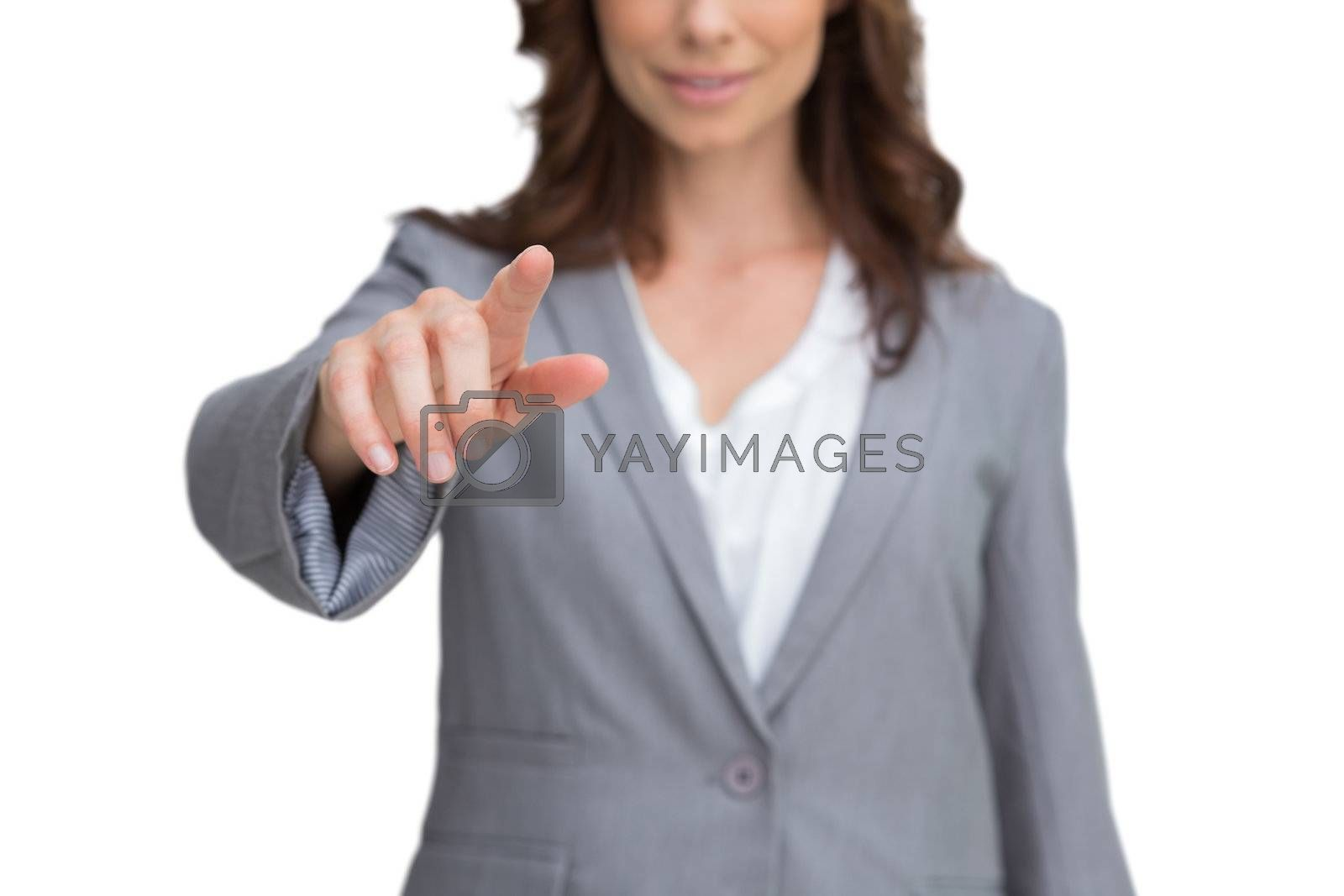 Smiling businesswoman pointing at screen by Wavebreakmedia