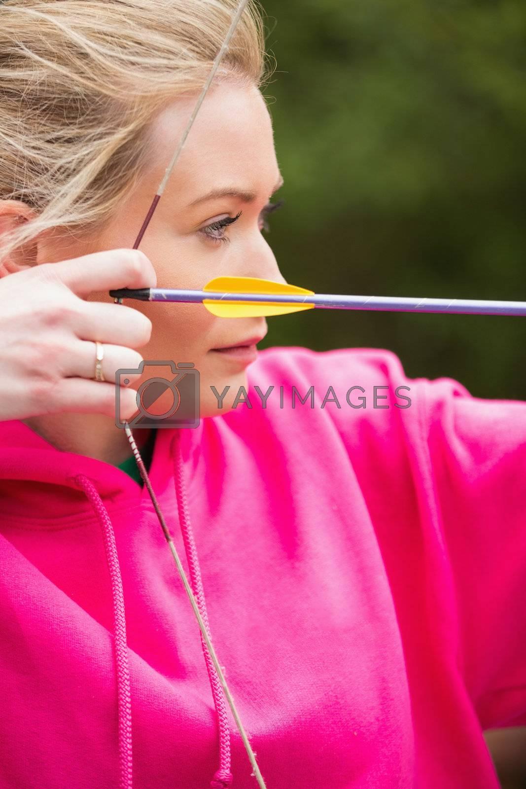 Focused blonde practicing archery by Wavebreakmedia
