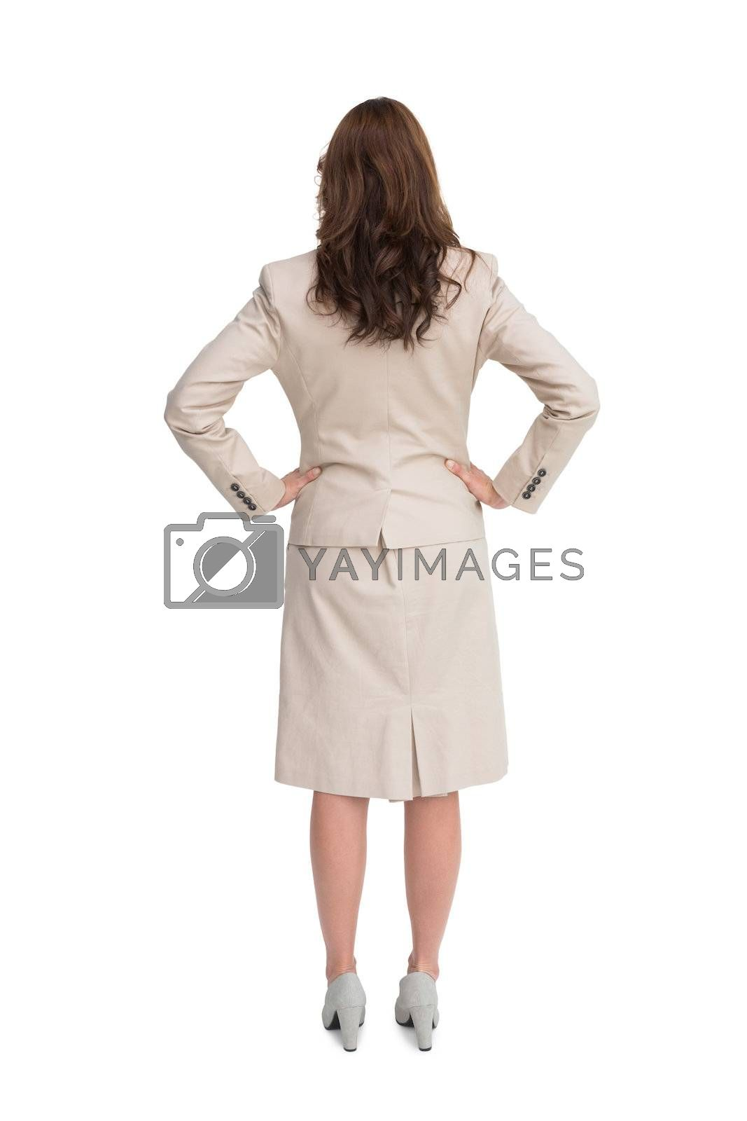Businesswoman standing back to camera by Wavebreakmedia