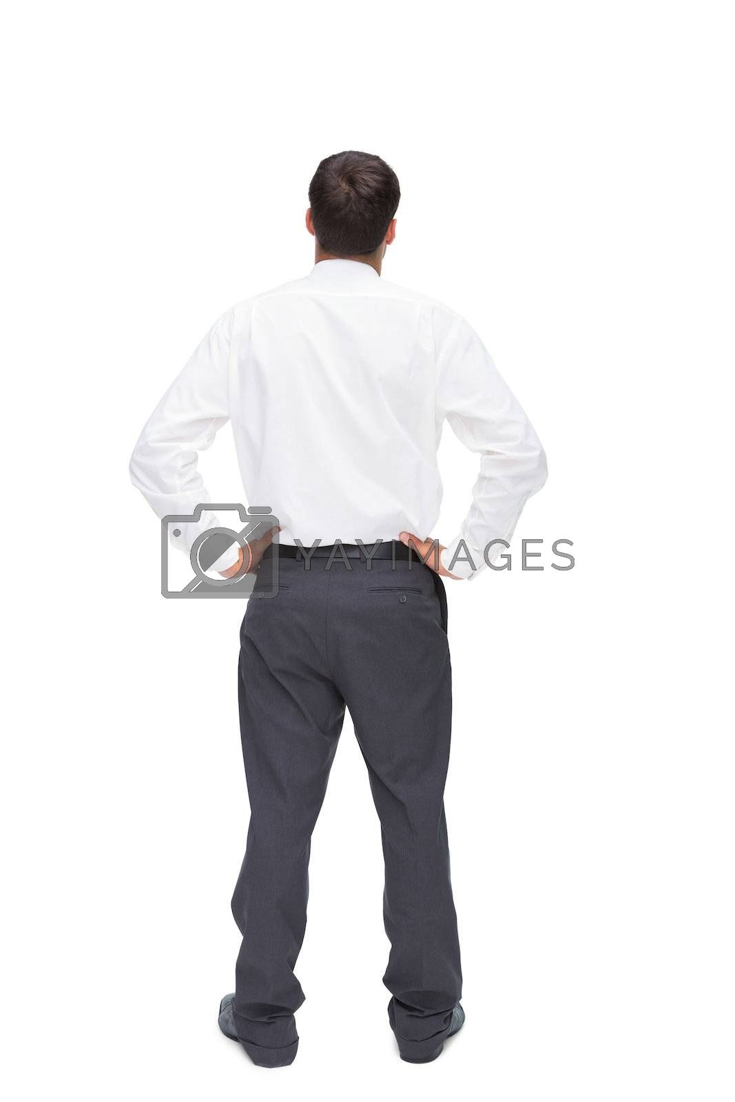 Rear view of classy young businessman posing by Wavebreakmedia