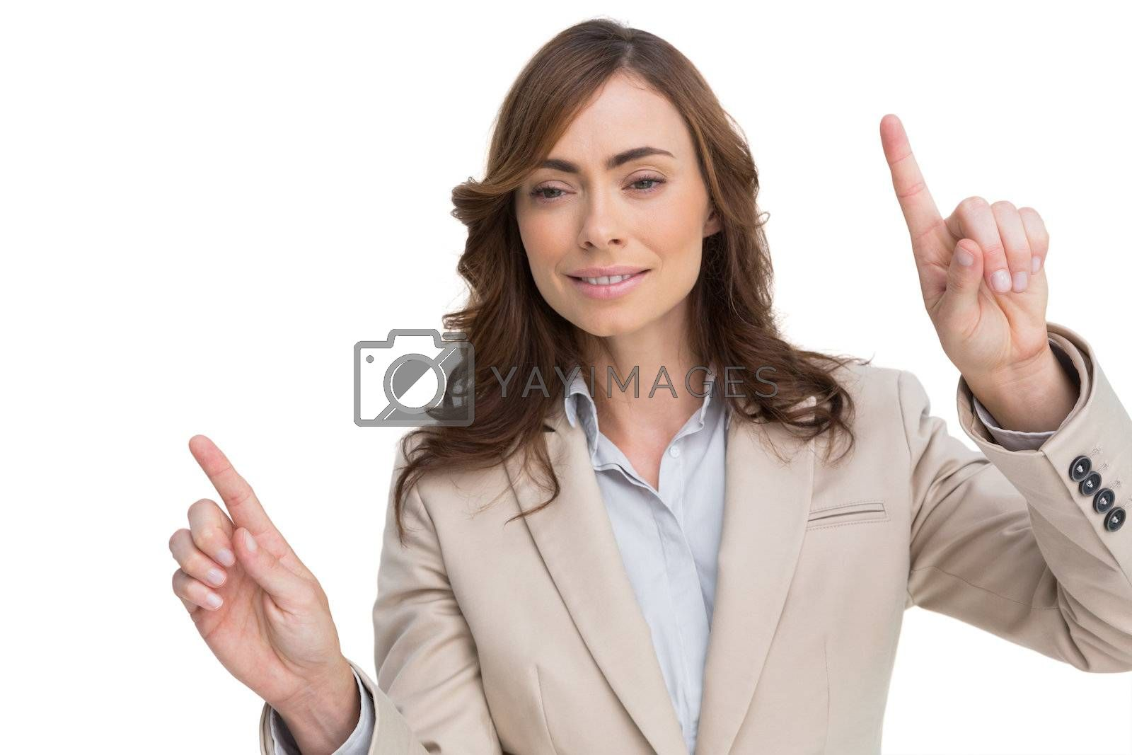 Businesswoman posing with fingers up by Wavebreakmedia