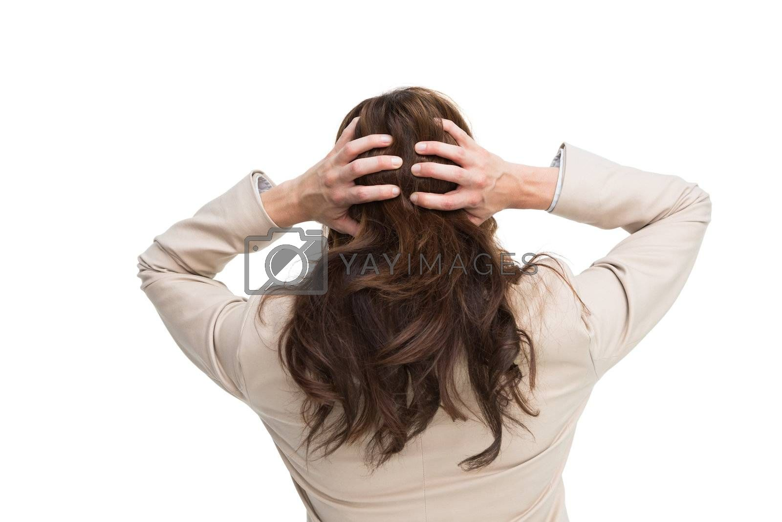 Young classy businesswoman with hands on head standing back to camera by Wavebreakmedia