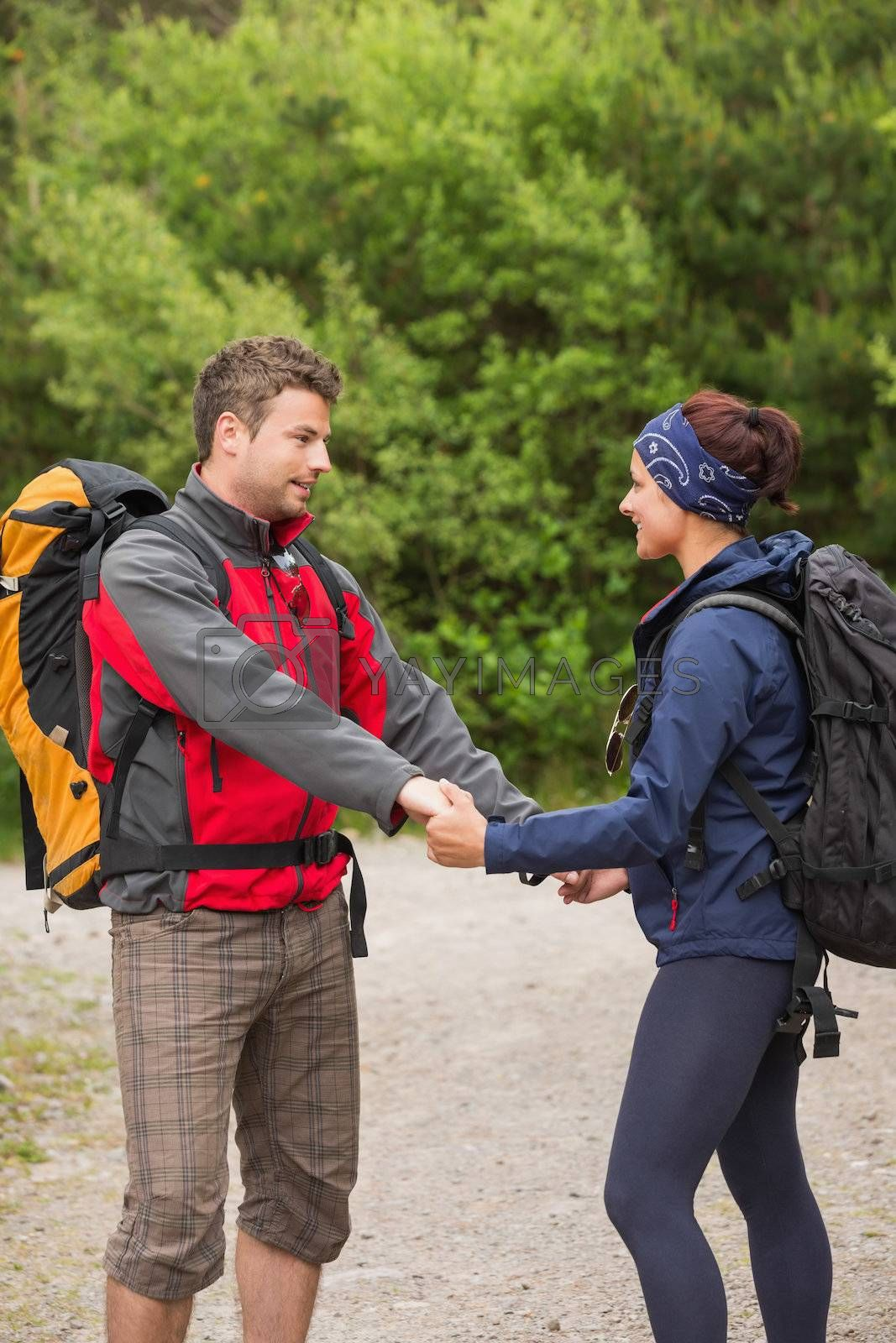 Cute couple going on a hike together holding hands by Wavebreakmedia