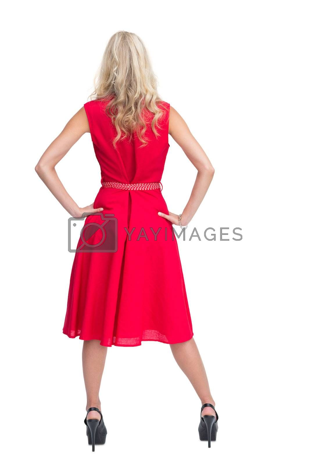 Rear view of gorgeous blonde in red dress posing by Wavebreakmedia