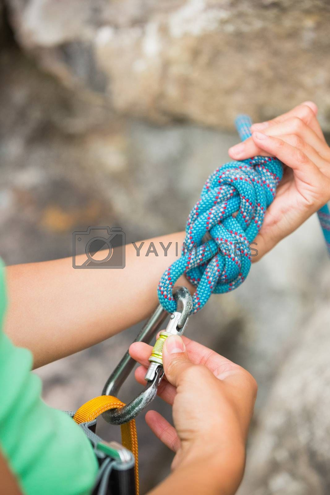 Female rock climber adjusting her harness by Wavebreakmedia