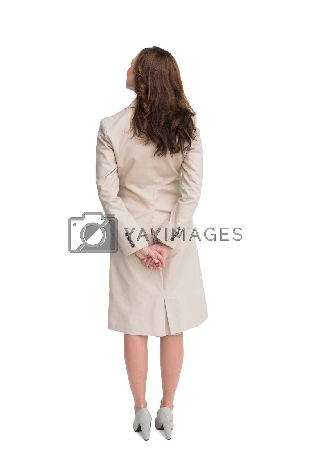 Rear view of businesswoman crossing hands behind back by Wavebreakmedia