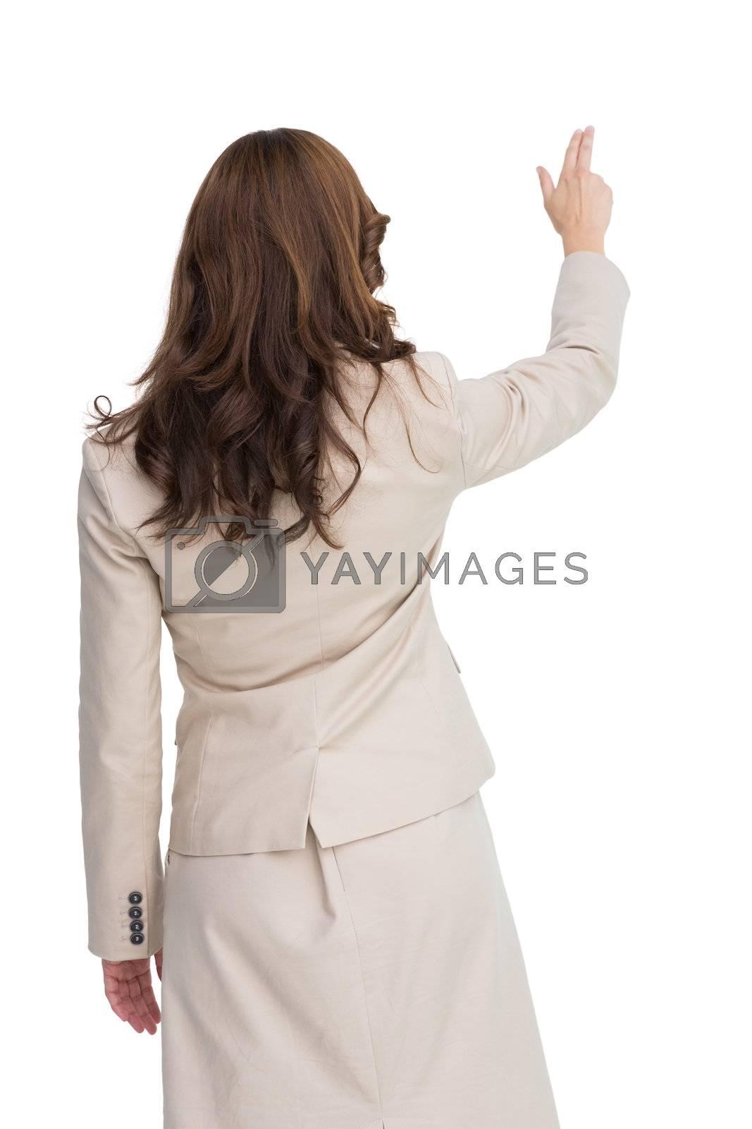 Brunette businesswoman standing back to camera by Wavebreakmedia