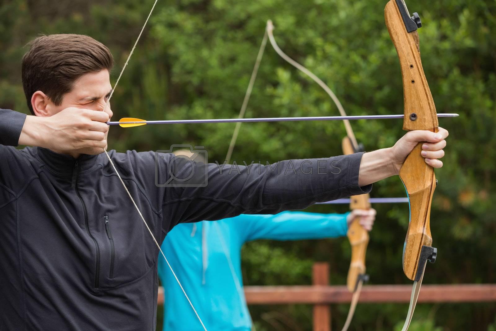 Handsome man practicing archery by Wavebreakmedia