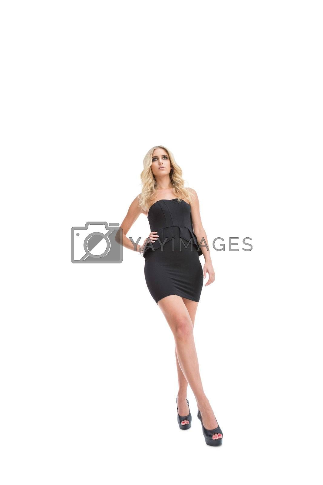 Low angle view of attractive blonde woman posing by Wavebreakmedia