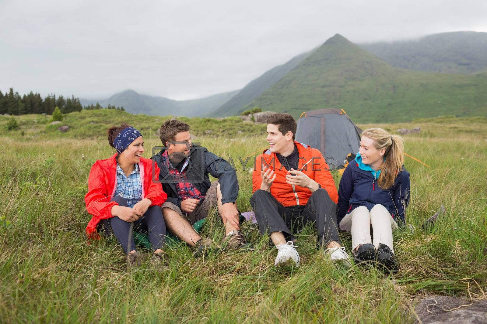 Friends chatting together on camping trip by Wavebreakmedia
