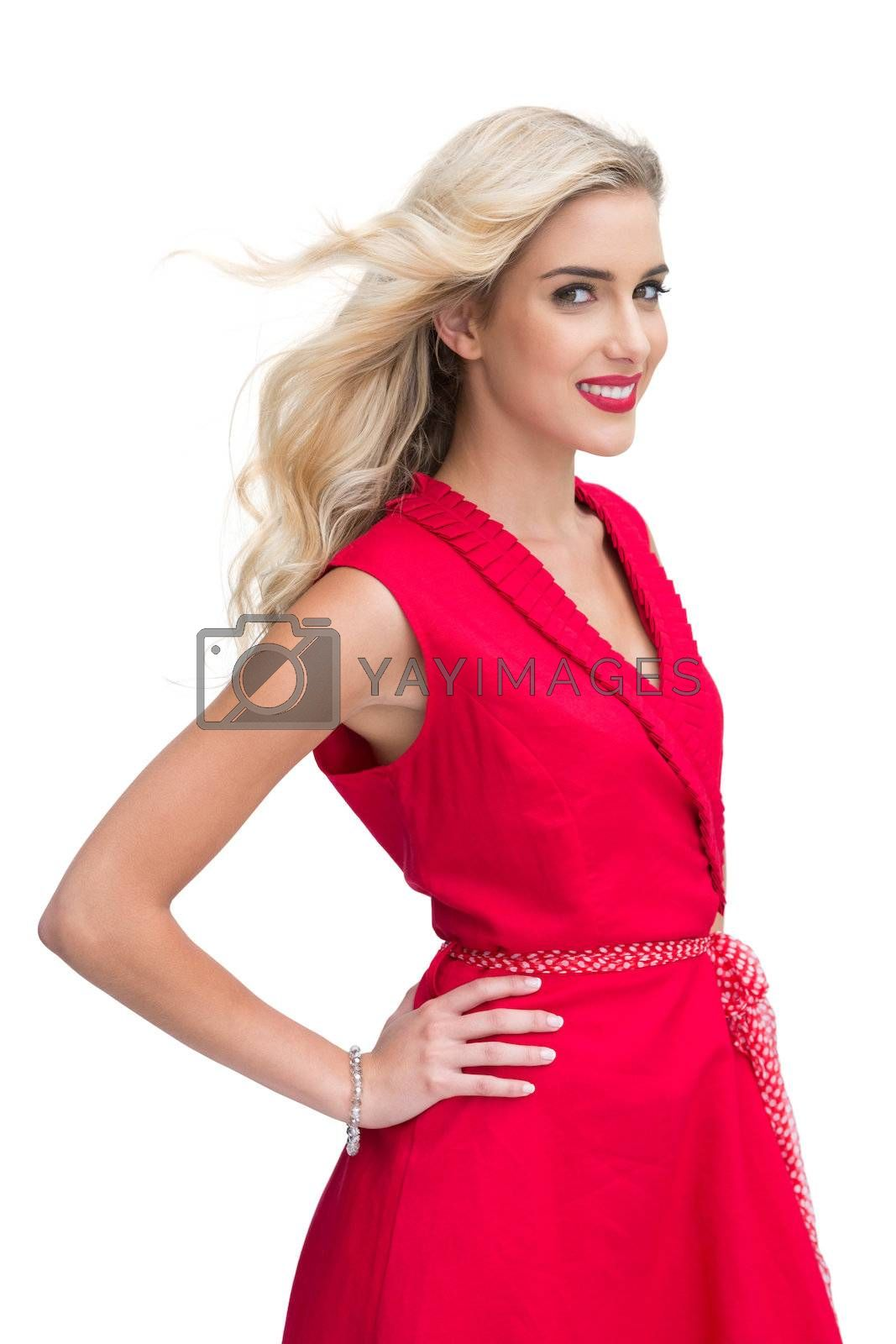 Beautiful woman wearing red dress smiling at camera by Wavebreakmedia