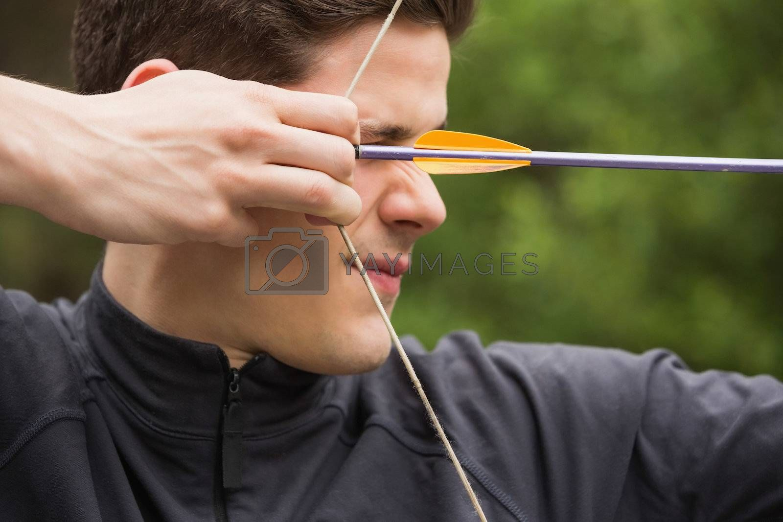 Concentrated man practicing archery by Wavebreakmedia