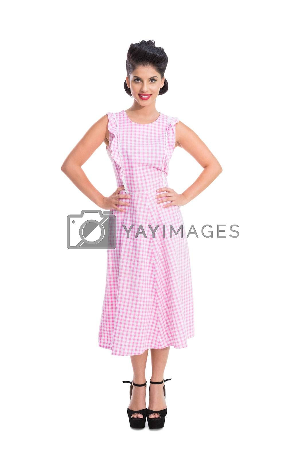 Beautiful retro woman standing  by Wavebreakmedia