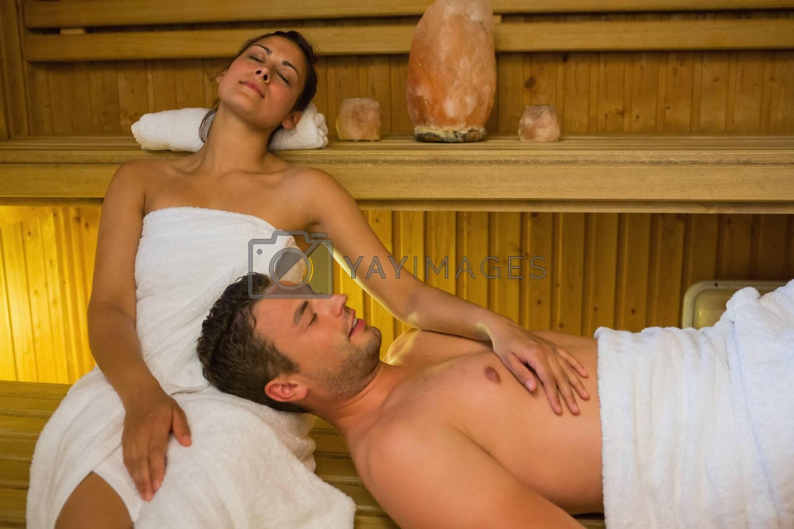 Loving couple relaxing in a sauna by Wavebreakmedia