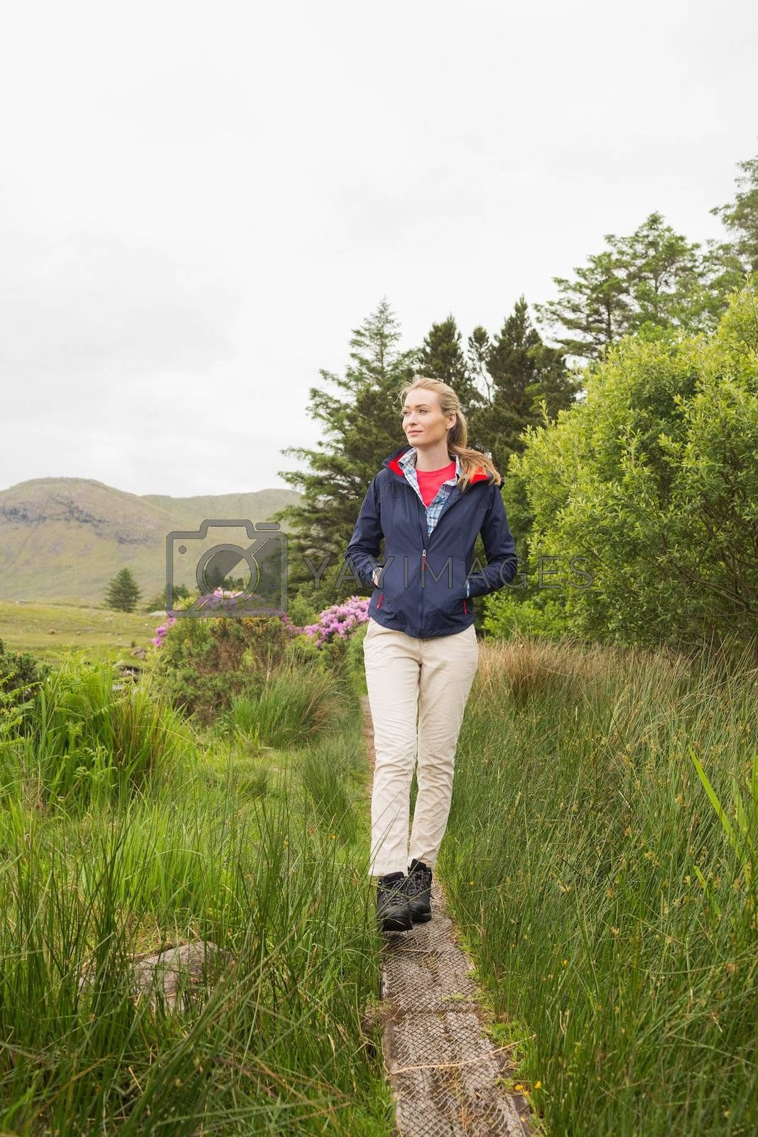 Blonde woman walking through the countryside by Wavebreakmedia