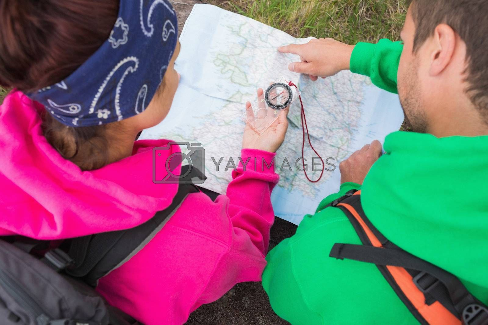 Couple using compass and map by Wavebreakmedia