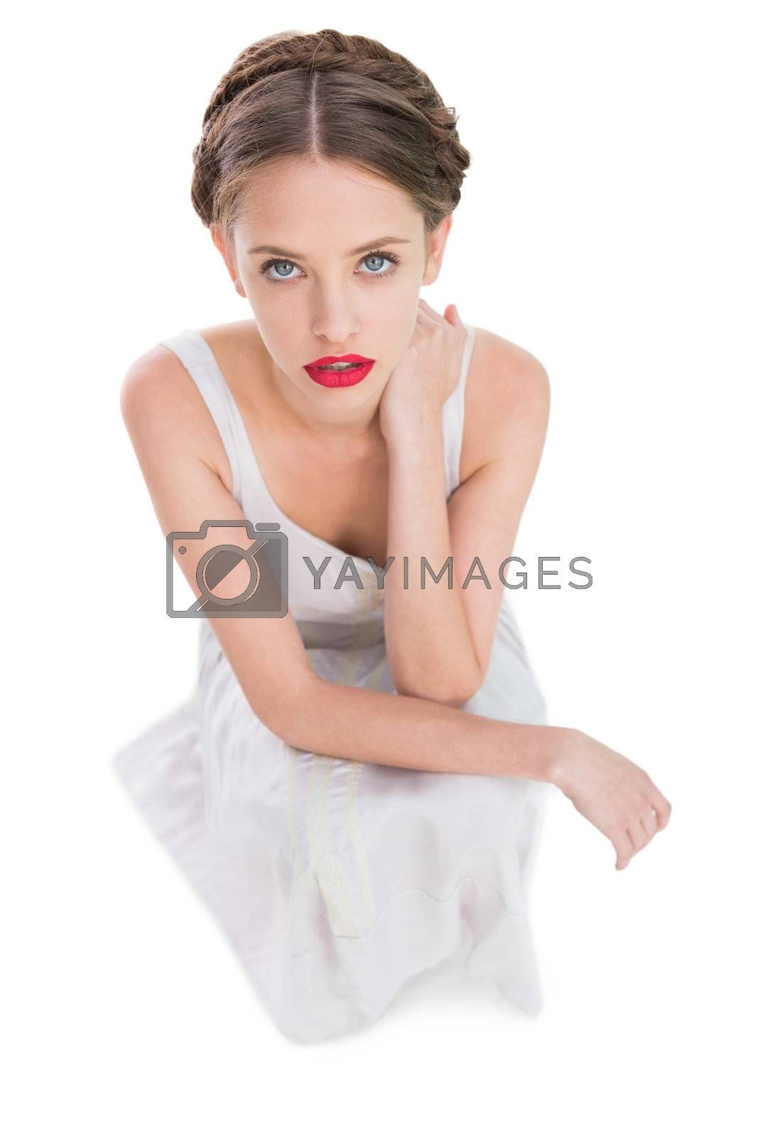 Woman sitting and looking at camera by Wavebreakmedia