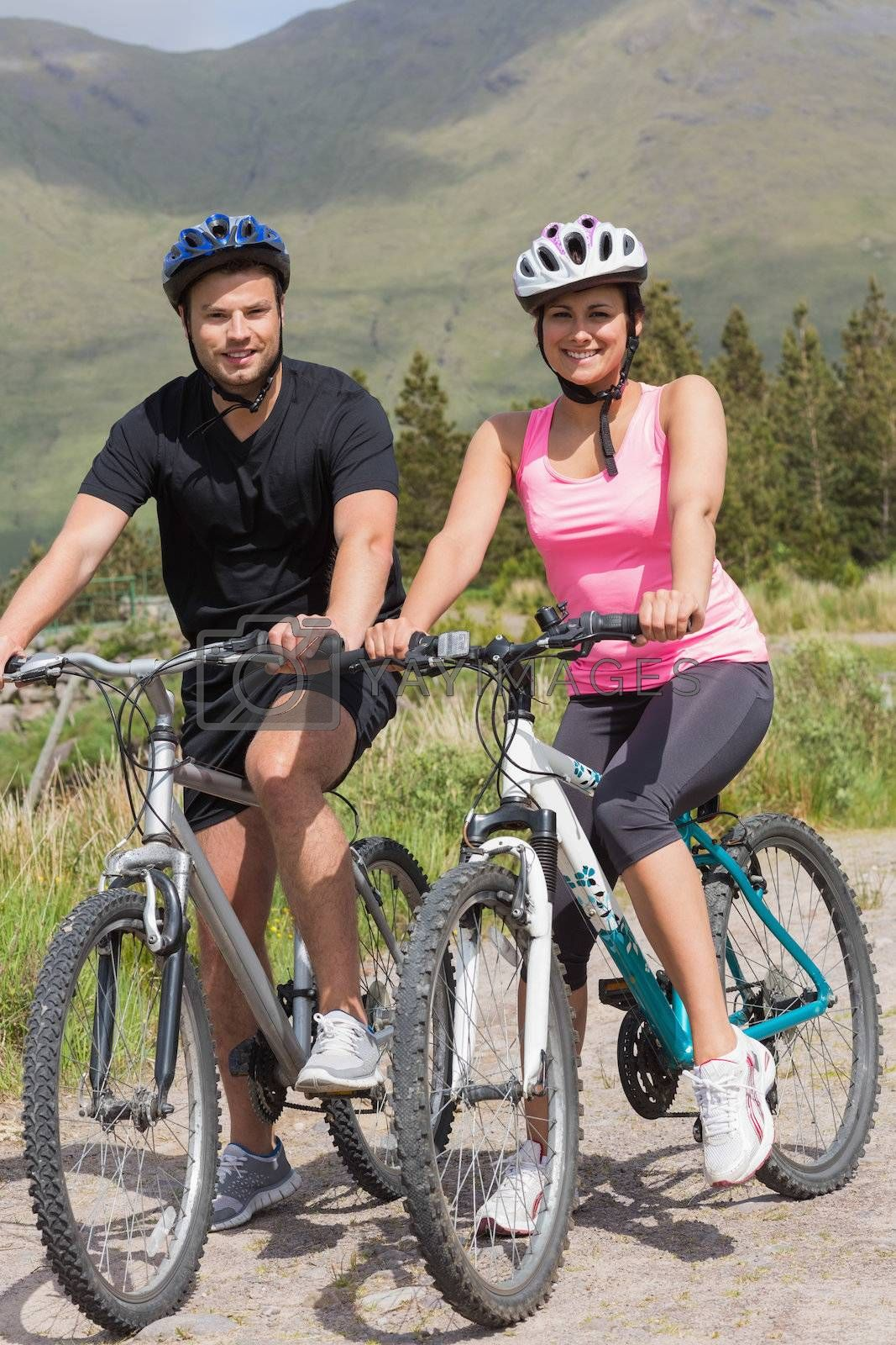 Happy couple on a bike ride by Wavebreakmedia