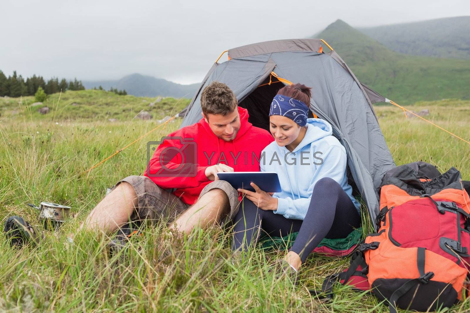 Couple on camping trip using a digital tablet by Wavebreakmedia