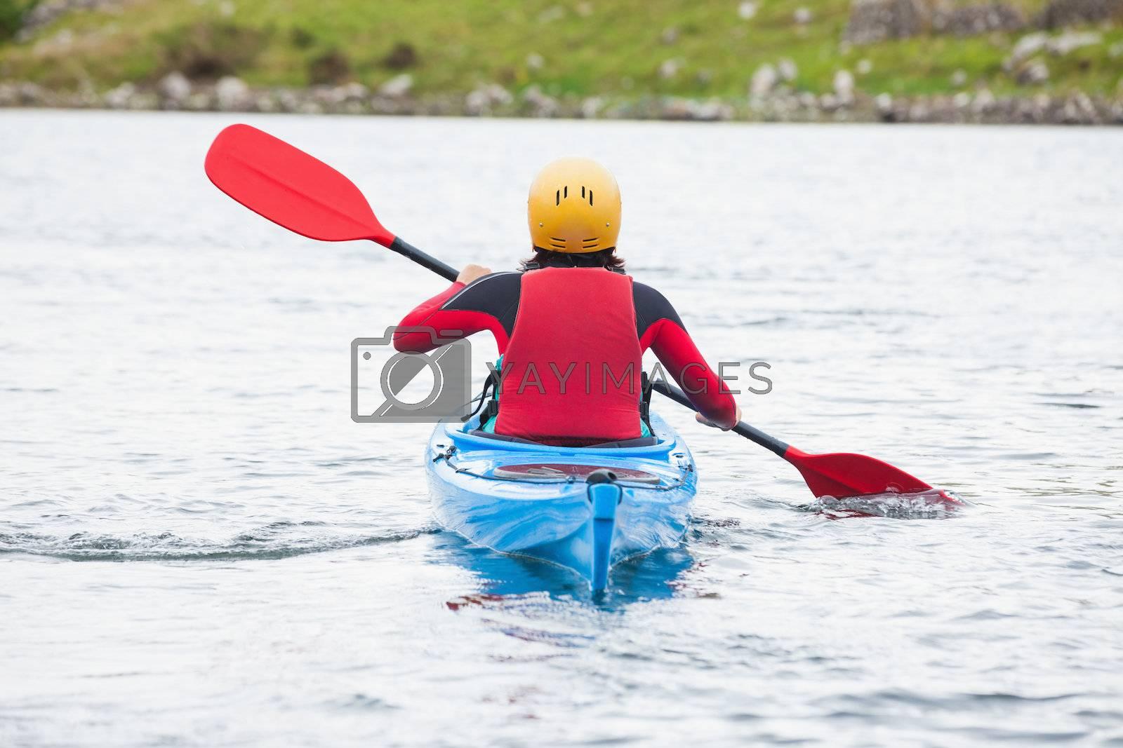 Woman rowing in a kayak by Wavebreakmedia