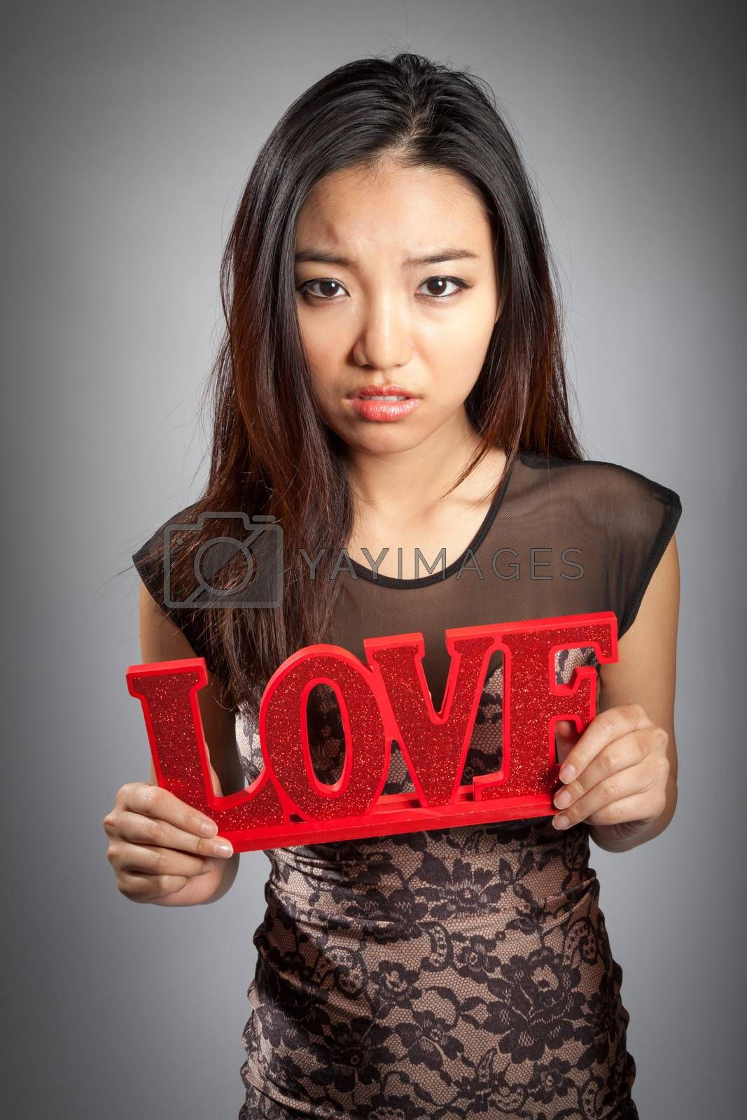 Romantic people in love shot in studio isolated on a grey background
