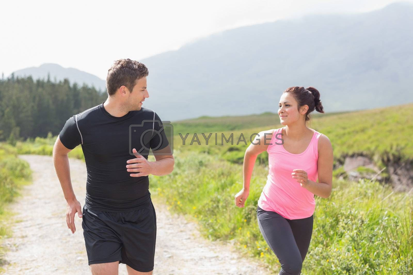 Athletic couple on a jog by Wavebreakmedia
